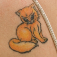 My tattoo may look cute, but I'm pretty sure it's plotting something. Look at those eyes!